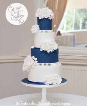4-tier-navy-and-white-wedding-cake-ivory-roses-navy-quilted-pearl-wedding-cake-2