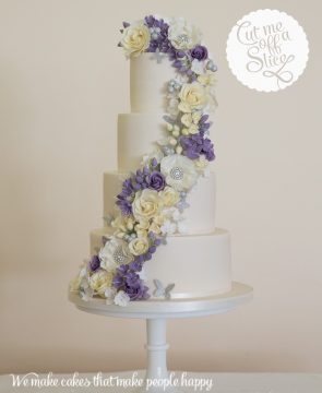 4 tier purple, lilac and cream flower cascade, sparkle, purple wedding cake freesia roses flowers